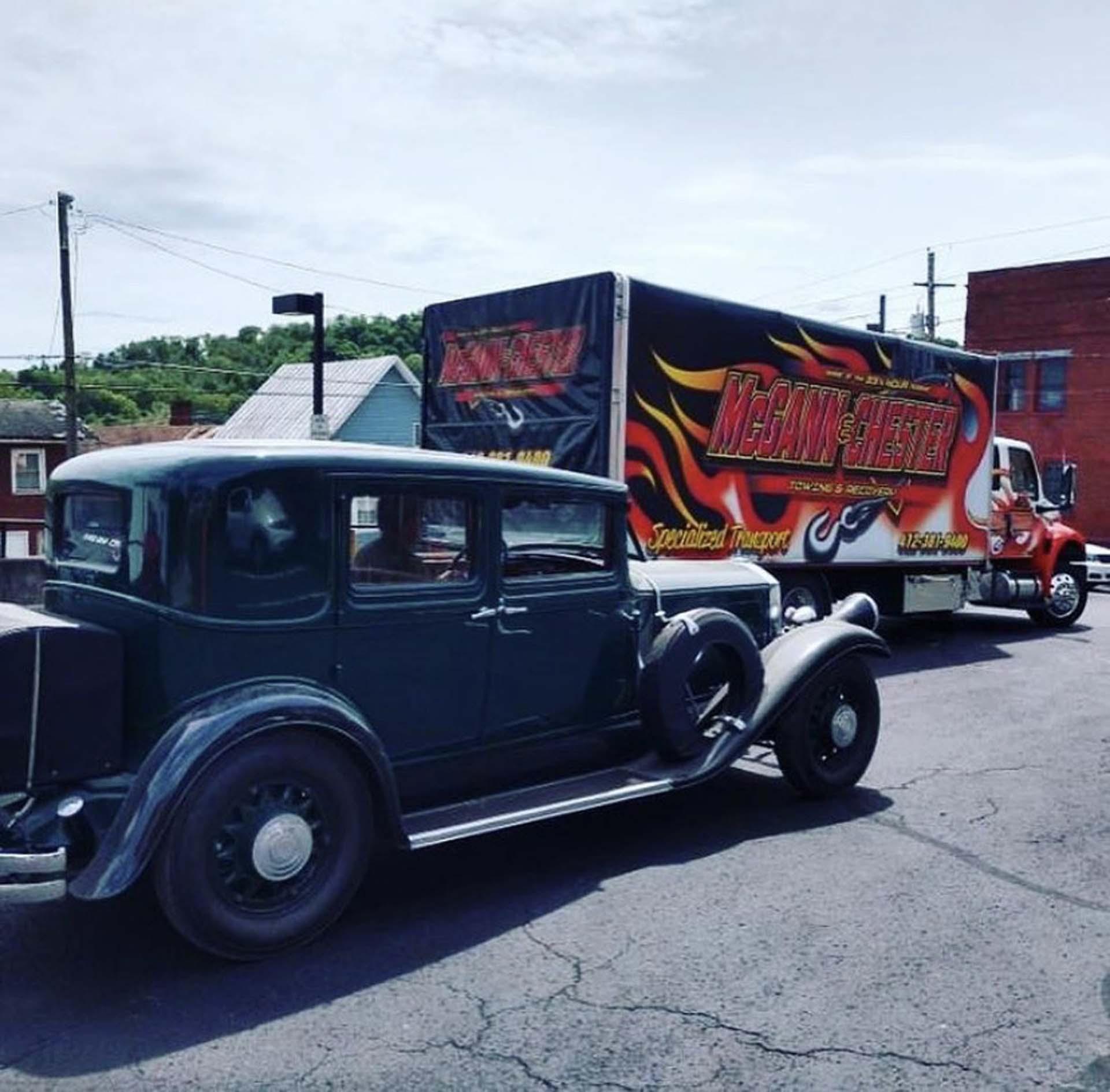 McGann & Chester truck & old car