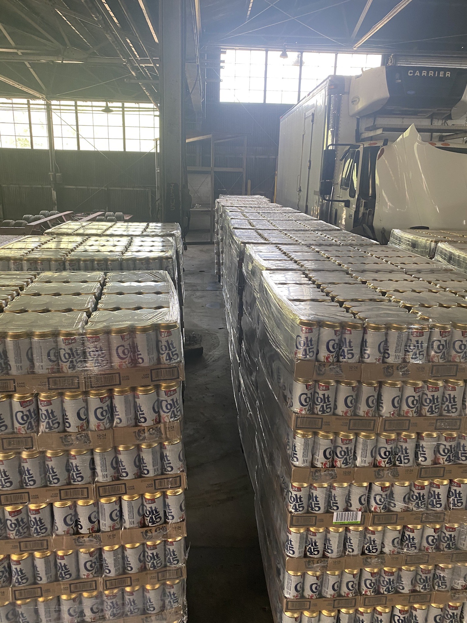cases of beer in a warehouse