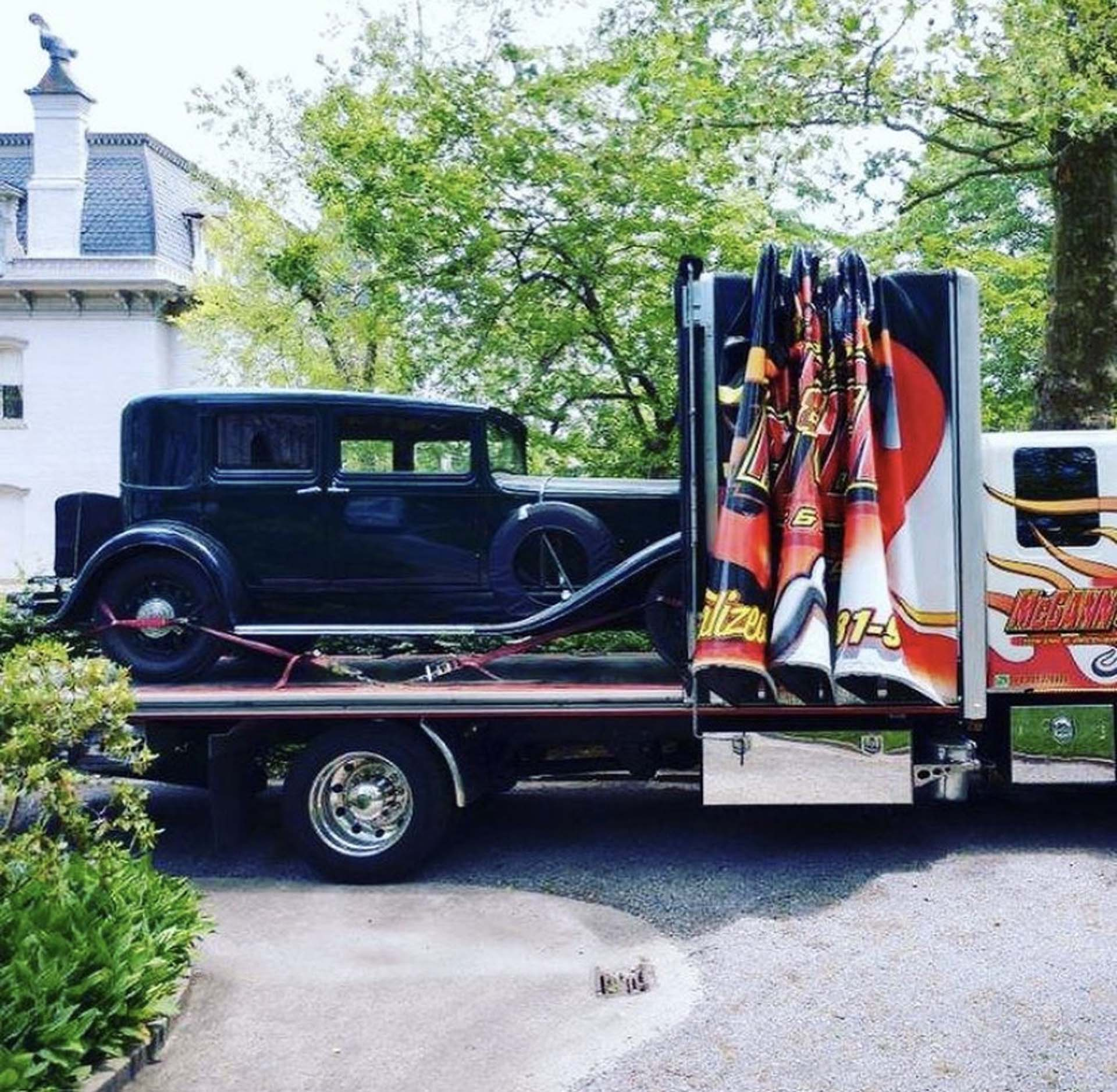 McGann & Chester truck towing old car